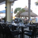 Patio dining room and oceanside tiki bar