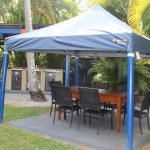 Gas barbeques and undercover seating beside the pool area