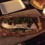 Whole roasted Mediterranean bass with salt crust and charred allium