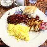 Corned beef hash, hash browns, scrambled eggs and biscuit.