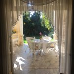 Looking from inside hotel out through terrace into garden
