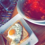 spaghetti with tomato sauce and breakfast egg toast