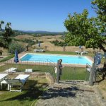Beautiful pool area with covered pergola overlooking the stunning views of the Tuscan countrysid