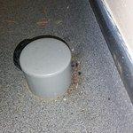 Dirt behind door stop in toilet