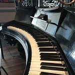 Curved piano