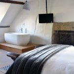 super king room with en suite and views of garden and valley