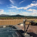 Outdoor hot tub on top floor overlooking mountains. Very Neat!