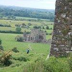 an abbey in valley below