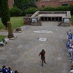 A Roman Centurion with school children in the Roman Gardens.
