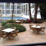 Patio area beside pool / smoking area