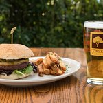 Roasted Shishito Peppers & Smoked Gouda atop a ground sirloin burger, house-cut fries & a pint.