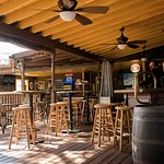 Indoor & outdoor seating. Large wrap-around porch, two large patios, quaint indoor dining room.