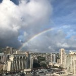 a rainbow over the city/residential sights from our balcony