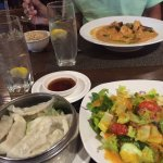 Steamed pork dumplings, house salad w/ ginger dressing and Thai Red Curry Shrimp