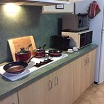 Kitchen equipped with non stick cookware, coffee machine, microwave and mini conventional ovens,
