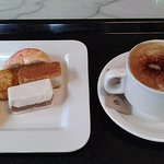 Chinese sweets plate and cappuccino