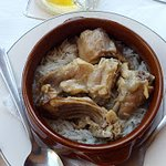 Rabbit with rice in a pot
