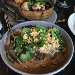 Massaman curry of braised lamb shank with salted duck egg