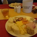 A very nice selection of cheeses and cold meat for breakfast, along with a range of breads