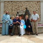 Pilgrim Family with Franciscan Friar.