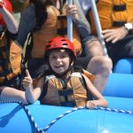 Cutie having a great time in the front of the raft!