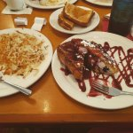 Blueberry cream cheese stuffed french toast with raspberry drizzle