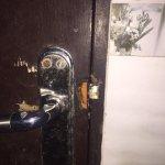Bathroom door broken lock was a trap.