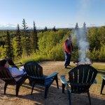 Enjoying sitting around the fire, making smores