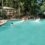 Cement sand beach on one side of rope and water slide on other