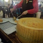 After mixing whiskey, Parmesan, and noodles, they plate and serve it!