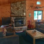River rock fireplace, knotty-pine interiors in The Marq