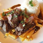 lomo saltado (top sirloin sauteed with onions and french fries... delicious!