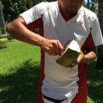 Staff cut up fresh coconut
