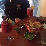 Strawberry margarita and nachos