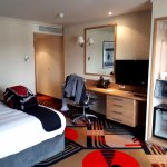 'Luxury room' with Fridge (not working) irons (work intermittently) TV (limited channel choice)