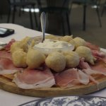 Prosciutto with Fried dough nuggets and cheese sauce.
