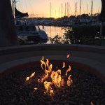 Twilight firepit overlooking the boats in the marina.