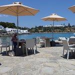 Water side bar area. Waterside villas with sunbeds in background