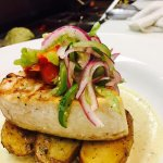 Grilled swordfish, roasted potatoes, baby carrots, poblano peppers cream sauce , tomatillo salsa