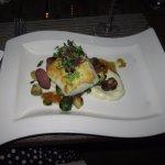 Mediterranean Sea Bass on roasted marble potatoes, fennel salad, chanterelle mushrooms, grüner v