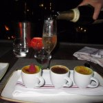 Teacups with three different kinds of creme brulee, and of course the champagne