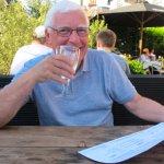 My husband enjoying a glass of wine while perusing the menu.