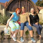 Sisters pose in front of the Botanical Garden Building
