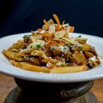 Penne PastaBeef tenderloin tips, black beans,  corn, tomatoes, red onions, mild  red chili sauc