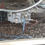wires (with wire nut) laying in the carpet inside furnace - fire hazard