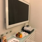 Big screen tv, fresh fruit, lots of drawers