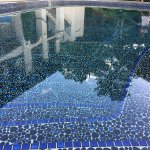 beautiful glass-tiled warm pool, hand built by the owner 30 years ago