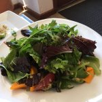 A highly recommended salad with fruits in vinaigrette dressing