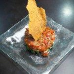 Signature Spicy Ahi Tuna Poke with sesame cracker