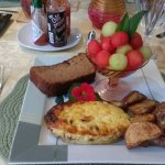 Breakfast day 1 - quiche, potatoes, cinnamon bread, and fruit